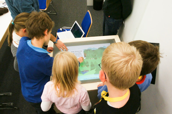 Children testing the prototype of the multitouch game station